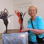 Karen with the sculpture she just purchased